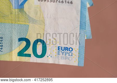 Selective Focus On Detail Of Euro Banknotes. Counting Or Giving Euro Banknotes. World Money Concept,