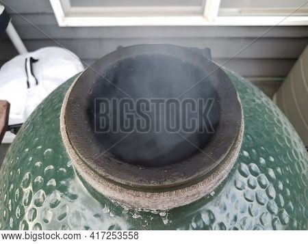 Smoke Rising From Big Green Metal Barbecue Grill