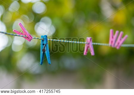 Clothespins On A Rope