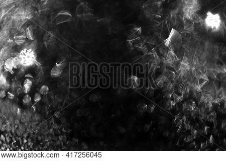 Abstract Dark Background Of Bokeh Water Drops On Glass. Defocus.