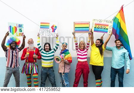 Happy Multiracial People Celebrating Gay Pride Event - Group Of Friends With Different Age And Race