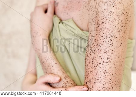 Woman Applying Body Exfoliating Scrub. Natural Organic Coffee Polish On Her Hands And Breast. Crop V