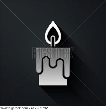 Silver Burning Candle Icon Isolated On Black Background. Cylindrical Candle Stick With Burning Flame