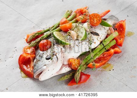 Dorade with herbs and vegetables prepared for roasting