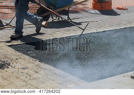 Road With Fresh Asphalt Reconstruction On Of Worker Repair Asphalt Covering