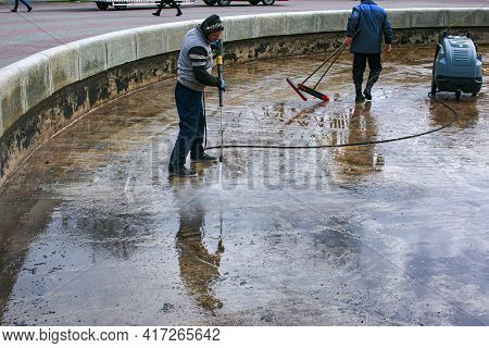 Dnepropetrovsk, Ukraine - 08.04.2021: Cleaning Of City Fountains In Spring Before Starting Work. Wor
