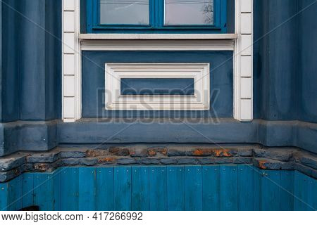 Vintage Blue Wall Background With Rough Painted Texture And Relievo Rectangle Frames Under Window. D