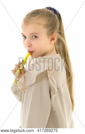 Cute Little Girl Licks A Candy. Concept Of Happy Childhood