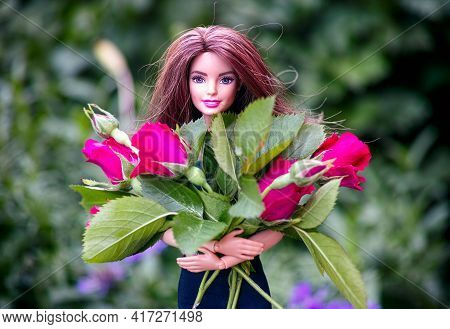 Tambov, Russian Federation - June 12, 2020 Barbie Doll With Big Bouquet Of Red Roses Outdoors.