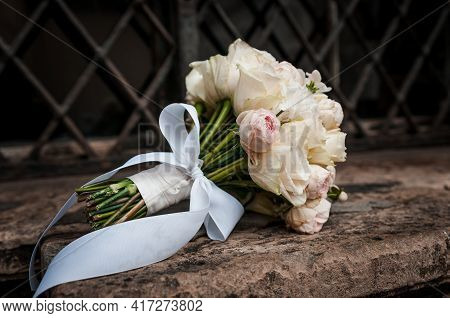 Bridal Bouquet With White And Pink Roses On A Brown Stone Background. Bridal Bouquet On A Background