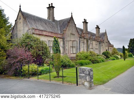 KILLARNEY, IRELAND - MAY 15, 2011: Muckross House and Grounds. Ireland's oldest National Park,  includes the Lakes of Killarney, as well as mountains and woodlands.