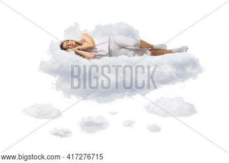 Young woman in pajamas sleeping on clouds isolated on white background