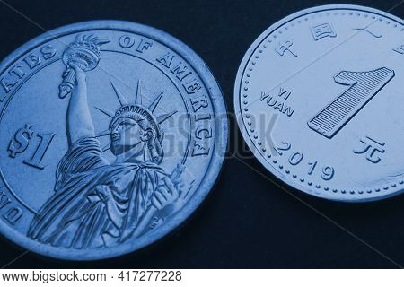 Translation: People's Bank Of China, One Yuan. 1 American Dollar And 1 Chinese Yuan Coins. Dark Blue