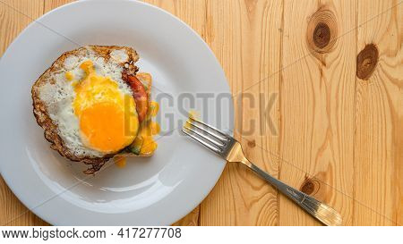 Homemade Sandwich With Fried Egg And Spread Yolk And Fork Top View Flat Lay Copy Space