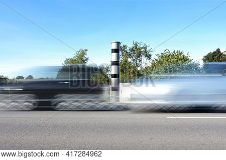 Fast Cars In Motion Blur In Front Of An Automatic Speed Measurement With Light Radar And Camera For