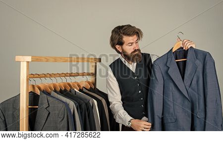 Bearded Man Collector Vintage Clothes Showing Formal Suit, Second Hand Store Concept