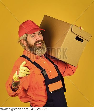 Service Delivery. Courier And Delivery. Postman Delivery Worker. Handsome Man Red Cap Yellow Backgro