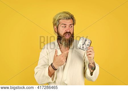 Surprised Man Turning Off Clock. Mature Man Turn Off Alarm Clock. Digital Alarm Clock. Time To Wake