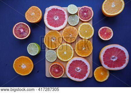 In The Photo, Sliced Fruits: Oranges, Tangerines, Lemon, Lime, Grapefruit. Composition Of Fresh Citr