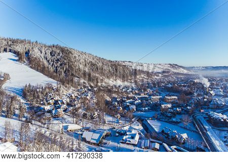 Beautiful Winter Scenery Of Houses Roads And Evergreen Forest Covered In Snow On Winter Morning. Aer