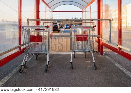 Shopping Trolleys Standing In Row Near Hypermarket.