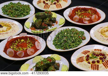 Lebanese Food Mezze, Includes Hummus, Muhammara, Moutabal, Taboule And Vine Leaves