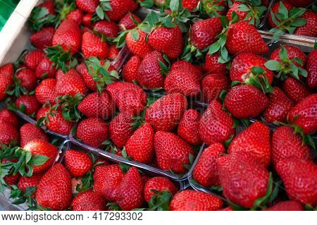Strawberries On The Market. Fresh, Red Strawberries Are Sold At The Bazaar
