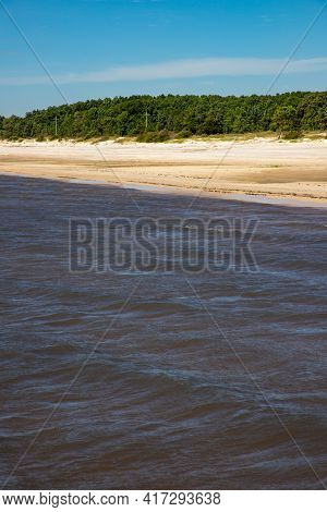 Sand And Vegetation With Blue Sky