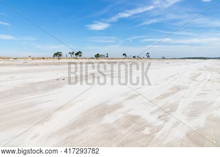 Sand And Vegetation With Blue Sky In Lagoa Dos Barros Lake, Osorio, Rio Grande Do Sul, Brazil