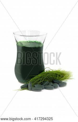 Wheatgrass Shot.  Healthy Detox Drink From Organic Green Wheat Grass Freshly Cut  And Tablets From D