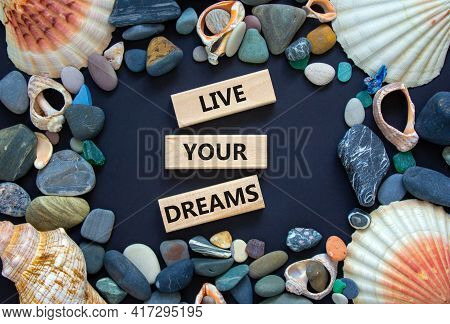 Live Your Dreams Symbol. Wooden Blocks With Words 'live Your Dreams'. Beautiful Black Background, Se