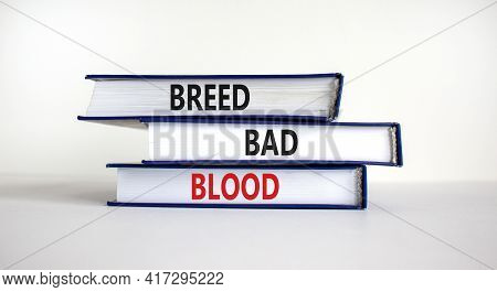 Breed Bad Blood Symbol. Books With Words 'breed Bad Blood'. Beautiful White Background, Copy Space.