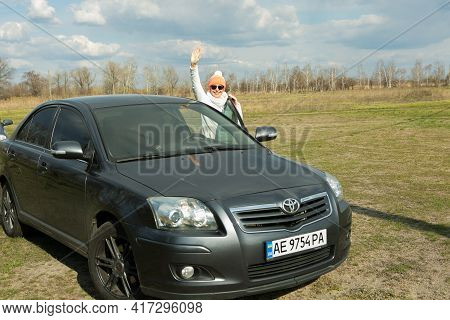 Dnepropetrovsk, Ukraine - 08.04.2021: Portrait Of A Beautiful Woman Near The Car. The Woman Often Tr