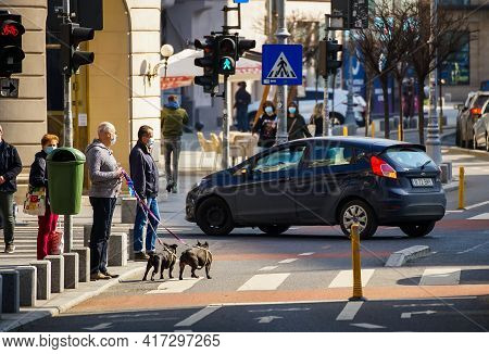 Bucharest, Romania - April 01, 2021: People Are Waiting To Cross The Street On The Victory Avenue Bi