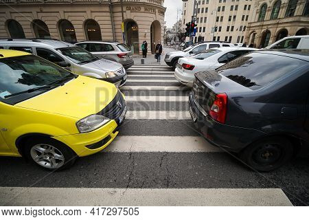 Bucharest, Romania - March 25, 2021: Cars In Traffic At Rush Hour On A Boulevard In Bucharest.