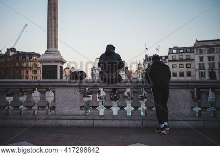 Soho, London   Uk -  2021.04.16: Men Chilling In Trafalgar Square On Sunny Friday Evening