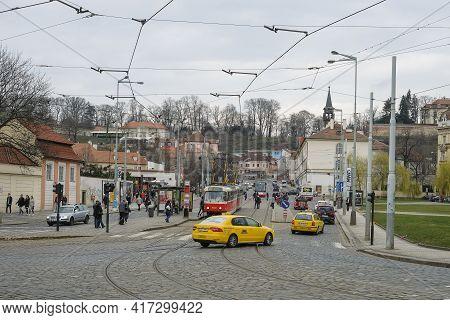 Prague, Czech Republic - March 5 2018: Famous Public Tram And Taxi Transportation On Prague City Cen