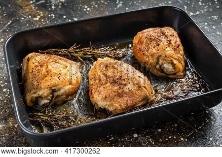 Oven Roasted Chicken Thighs With In Baking Dish. Brown Background. Top View