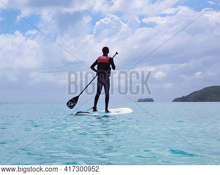Whitehaven Beach, Whitsundays, Queensland, Australia - April 2021: Male In Stinger Suit Standing On