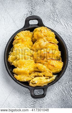 Baked Potato Gratin Dauphinois In A Pan. White Background. Top View