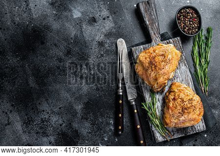 Bbq Grilled Chicken Thighs On A Wooden Board With Rosemary. Black Background. Top View. Copy Space