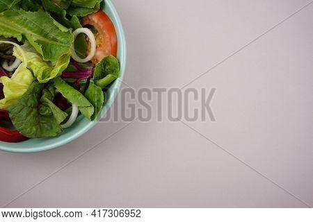 Vegetable Salad. Vegan, Vegetarian Healthy, Diet Nutrient Meal In Green Bowl On Gray Paper Backgroun