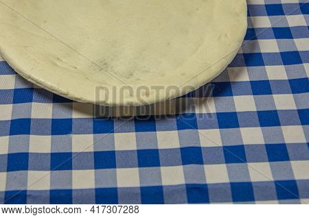 Homemade Pizza Dough On Blue Towel Background