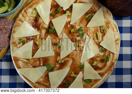 Pizza With Tarantella Sauce And Cheese In Preparation