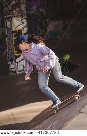 Southbank, London   Uk -  2021.04.17: Young Girl Skater Performing Tricks At The Southbank Skate Spa