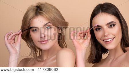 Two Young Women Correcting Eyebrow Shape With Brush, Closeup. Girls With Eyebrow Correction Procedur