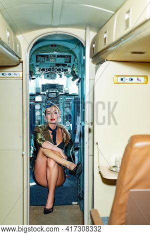 On A Board Of Commercial Airplane. Stewardess In Blue Uniform. Stewardess Dressed In Uniform In The