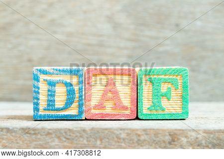 Color Alphabet Letter Block In Word Daf (abbreviation Of Delivered At Frontier) On Wood Background