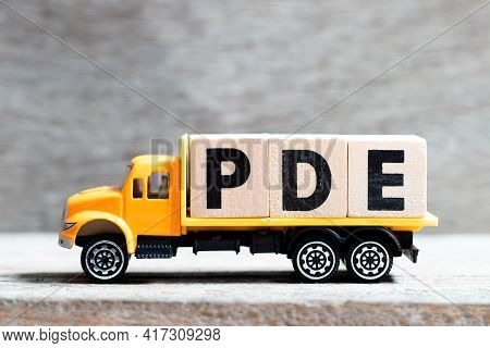 Truck Hold Letter Block In Word Pde (abbreviation Of Permitted Daily Exposure, Partial Differential