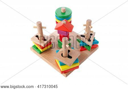 Sorter Of Abstract And Geometric Shapes. The Material Is Wood. Educational Toy Montessori. White Bac